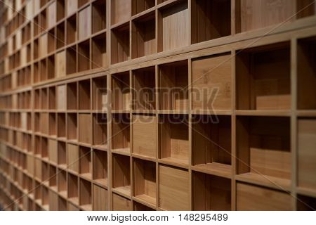 Background of empty wooden square shelves of music studio wall