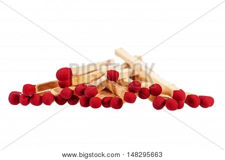 Heap of matches with rd heads isolated on white background close up