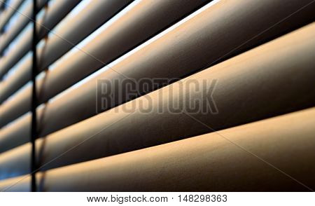 Modern Wooden Blinds With Shadow In Sunlight