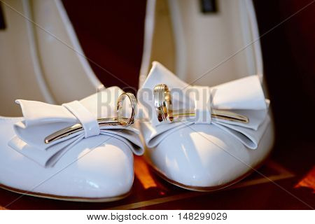 Beautiful Wedding Rings For Bride And Groom. Beauty Of Wedding Accessories Indoors. Close-up Bridal