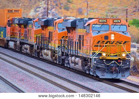 September 19, 2016 in Cajon, CA:  BNSF Freight Train heading southbound toward Los Angeles transporting commerce to Southern California and beyond taken in Cajon, CA where train enthusiasts get great views of trains