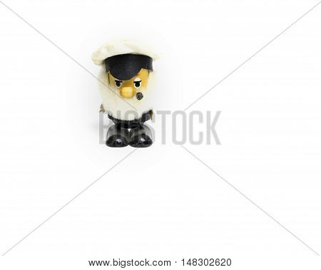Toy model. figure of a sailor with a pipe on a white background