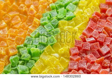 Dried pineapple, candied fruits in a row, four colors