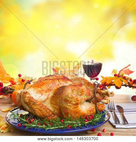 Thnaksgiving dish - turkey with pumpkins and fall leaves background