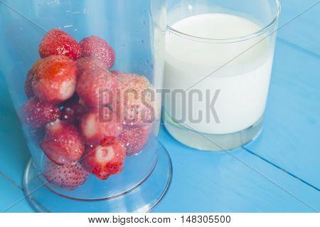 Ingridient for strawberry milkshake - strawberries in glass, milk