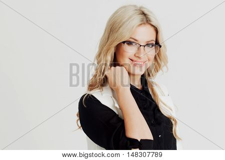 Happy and surprised young confident business lady