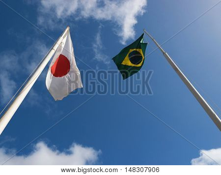 Flags of Japan and Brazil waving wind