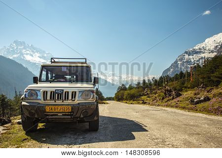 Sikkim India - April 13 2013: The Off Road car with snow moutain on background in Sikkim India