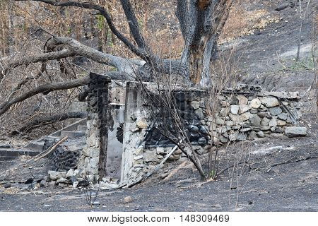 Burned down home with just the foundation left standing taken after a wildfire
