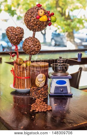 Coffee grinder candle. coffee tree and coffee beans