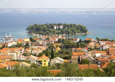 Island Galevac with Franciscan monastery and Croatian town Preko
