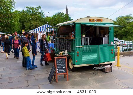 Edinburgh Scotland - September 10 2016: Farmers Market in Edinburgh with unidentified people. The award-winning market takes place at Castle Terrace under the imposing backdrop of Edinburgh Castle