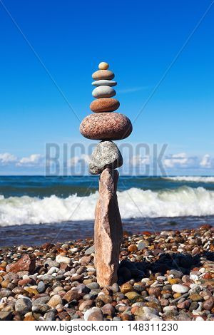 concept of tranquility and balance. Rock zen in the form of a pyramid on the edge of the stone