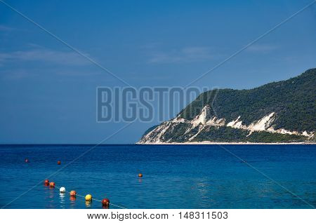 The seaside cliff covered with pine forest on the island of Lefkada