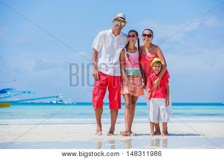 Happy family having fun on tropical beach