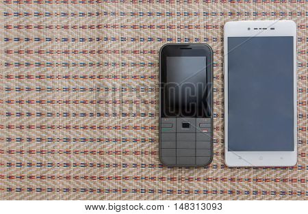 Phone keypad Smart phones and tablet. On patterns background copy space.