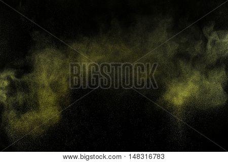 Gold Powder Explosion On Black Background.