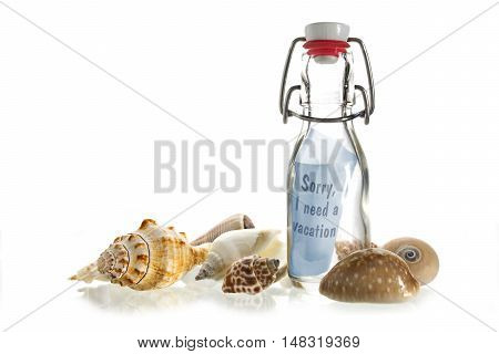 Sorry I need a vacation message in a bottle of glass between some sea shells isolated on a white background