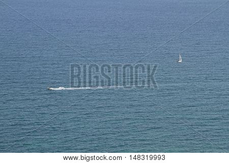 aerial view of a motor boat and a catamaran plying the sea