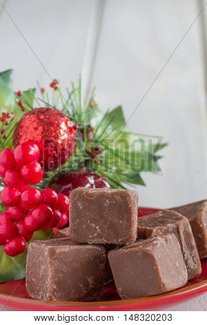 Christmas Chocolate Fudge on White Wooden Table with Copy Space Top Vertical