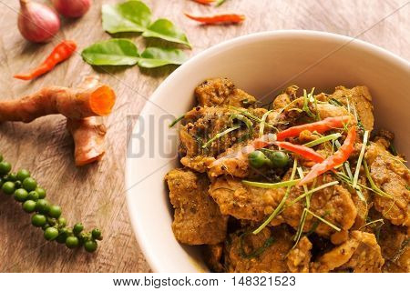 Hot and spicy pork curry traditional local Thai food with herbs pepper turmeric chili onion and kaffir lime leaves. Delicious and famous Thailand food.