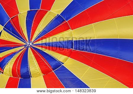 Blue Yellow Red Close-up view of a colourful hot-air balloon to use as background
