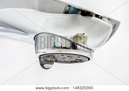 wash basin and running water from the tap in chrome bathroom