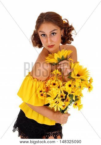 Gorgeous young woman in a yellow blouse holding a bunch of sunflowers standing isolated for white background.