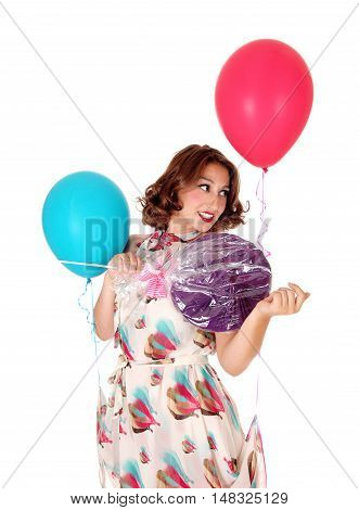 A pretty woman with two balloons and a big lollipop standing closeup isolated for white background.