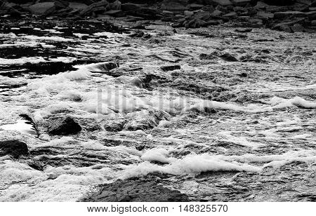 Fast river Tosna in Leningrad Region Russia. Black and white.