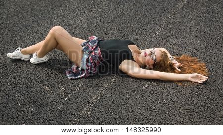 Pretty Young Girl Laying On Asphalt