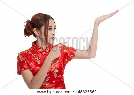 Asian Girl In Chinese Cheongsam Dress Point To  Blank Space On Her Hand.