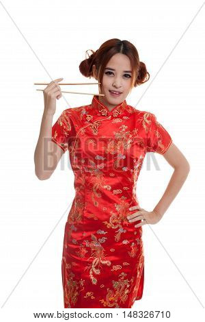 Asian Girl In Chinese Cheongsam Dress With  Chopsticks.