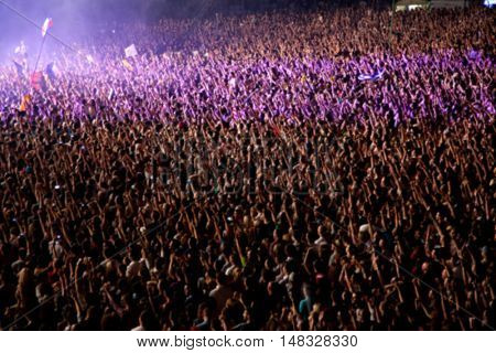 Blurred crowd of people partying at a concert
