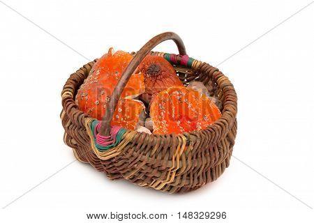 Basket with Amanita muscaria mushrooms. Orange toadstools. Isolated