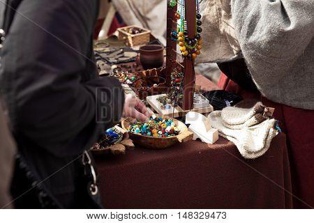 Flea market, buyers are buying handmade jewelry