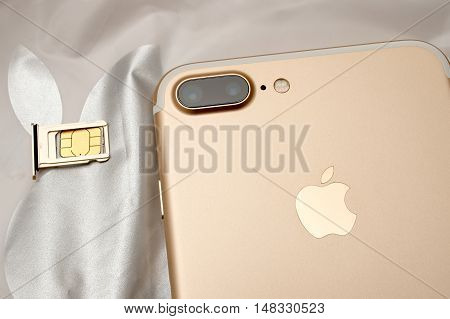 PARIS FRANCE - SEP 16 2016: New Apple iPhone 7 Plus unboxed in the first day of sales - inserting SIM card in new phone. New Apple iPhone claims to become the most popular smart phone in the world in 2016