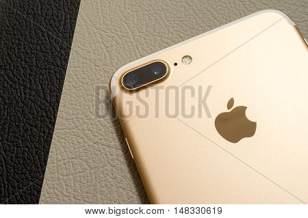 PARIS FRANCE - SEP 16 2016: New Apple iPhone 7 Plus unboxed in the first day of sales - two camera lenses rear view on colorful background. New Apple iPhone aclaims to become the most popular smart phone in the world in 2016