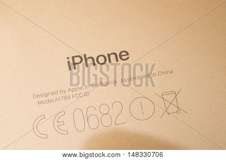 PARIS FRANCE - SEP 16 2016: New Apple iPhone 7 Plus unboxing in the first day of sales - graved brand on gold phone . New Apple iPhone acclaims to become the most popular smart phone in the world in 2016
