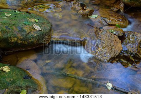 A stream in Pennsylvania that has been stained orange by acid mine drainage. This is a direct result of unregulated coal mining.