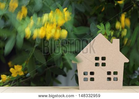 wooden toy house with beautiful blossom tree in background