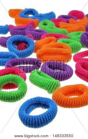 Pile of colorful scrunchies isolated on white background with clipping path