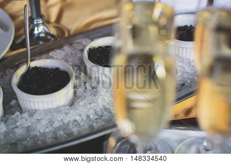 Beautifully Luxury Decorated Catering Banquet Table With Black And Red Caviar And Different Food Sna