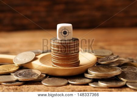 coin in wooden spoon and dice on top concept idea for business and goal for save money.