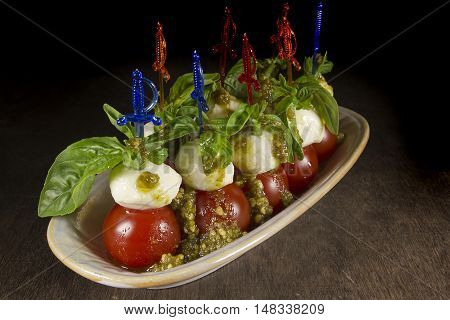 Canape Caprese for buffet on a wooden table