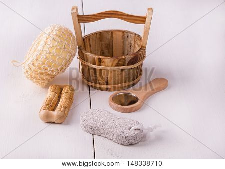 Variety of natural bath broung tools on white wooden table