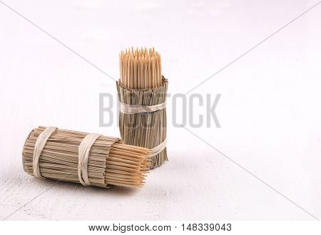 wooden toothpicks in a package on the white table