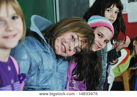 happy childrens group in school have fun