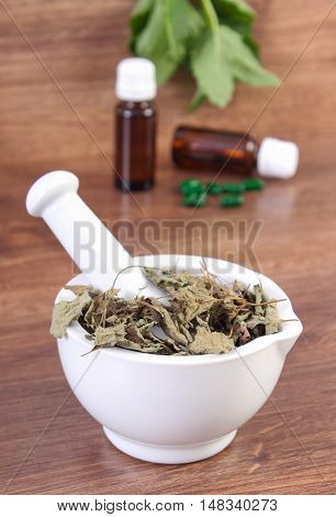Fresh And Dried Lemon Balm In Mortar And Medical Capsules, Choice Between Pills And Alternative Medi