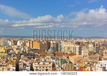 Aerial view of Valencia old city architecture around Central Market (Mercado Central). City skyline with mountains on horizon in Valencia Spain